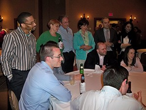 Members of both WVOS and WVPTA are enthralled by the table magic of John Slicer.