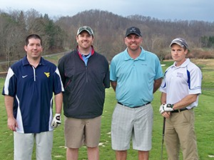 Steve Smith, Jon Abraham, Doug Green and WV Physical Therapy Association President Eric Tarr, PT, DPT, MBA, OCS (right), try to golf before the storm.