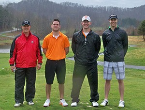 Physical therapists Scott Wilson, Todd Dillon, Brad Dillon and Brandon Beacom enjoyed the improving afternoon.