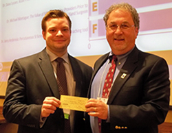 """Our first place resident presentation prize was awarded to Andrew Hanselman, MD, WVU Department of Orthopaedics, for """"Timing of Airflow Activation Impacts Contamination from Filtered-Exhaust Helmets for Arthroplasty Surgery.""""  We thank Stryker for their assistance in this project."""